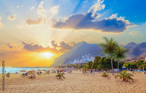 Photo sur Aluminium Iles Canaries Beautiful summer scene on Teresitas beach with people enjoying holiday in sunset light, in Tenerife, Canary island of Spain