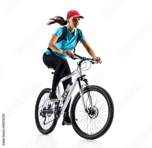 Cyclist in blue t-shirt riding the bike in silhouette on white background. Dynamic movement. Sport and healthy lifestyle