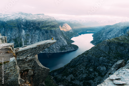 Spoed Foto op Canvas Scandinavië Breathtaking view of Trolltunga rock - most spectacular and famous scenic cliff in Norway. Picturesque landscape with sunset sky and clear lake