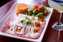Enchilada Plate In Red Sauce With Mexican Rice And Margarita With Lime