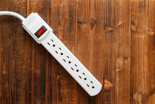 Electrical Power Strip On Wood. Top Down View.
