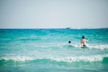 Brothers Splashing In The Ocean