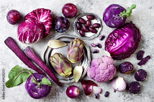 Poster  Raw purple vegetables over gray concrete background