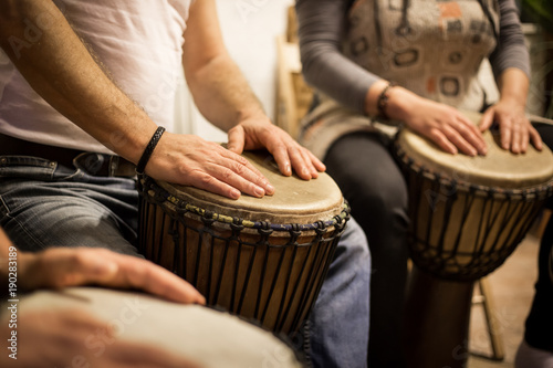 Close up of hands on african drums, drumming for a music therapy - 190283189