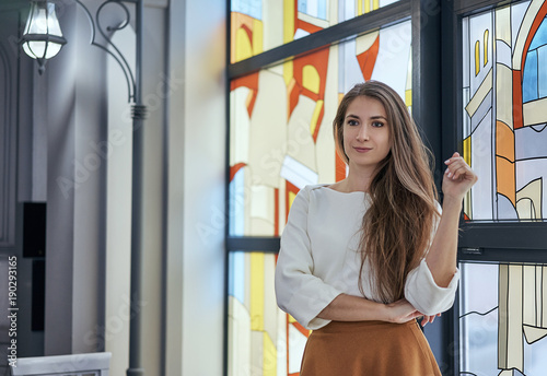 Photo girl with long hair near the stained glass