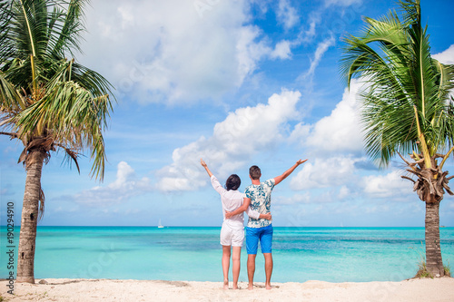 Young couple on white beach. Happy family on honeymoon vacation Fototapeta
