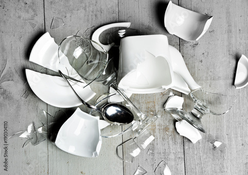 Fotografija  Glass broken dishes crashed wine glass tea cups sauser spoon with fragments on m