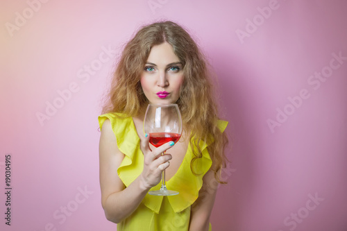 Obraz na plátně attractive young woman drink red wine and look at you