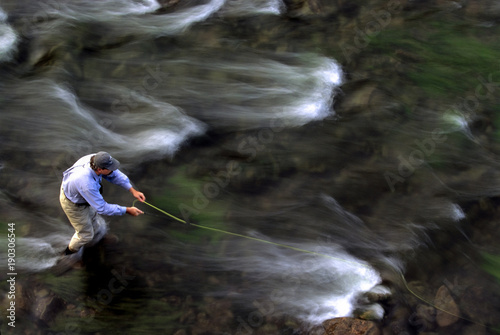 Fly Fisherman with Moving Water