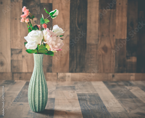 Artificial Flowers On A Wooden Background In A Teal Vase Buy This