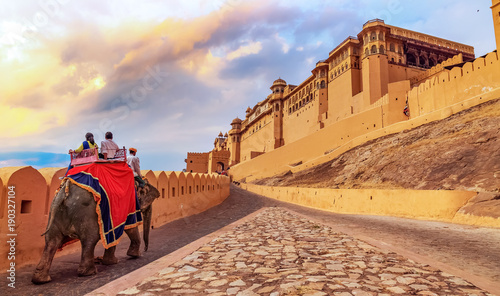 Fototapeta  Amer Fort Jaipur - Tourists enjoy elephant ride at sunrise