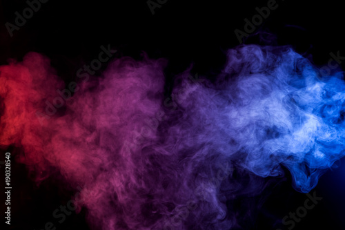 Fotobehang Rook Dense multicolored smoke of red and blue colors on a black isolated background. Background of smoke vape