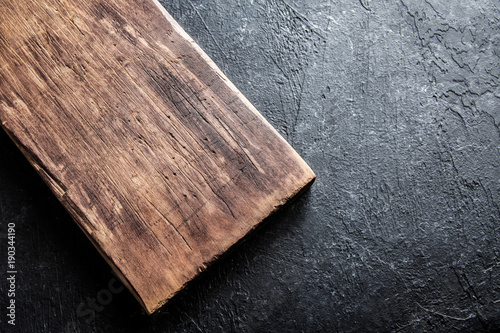 cutting board on black stone background