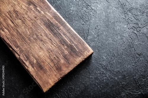 cutting board on black stone background