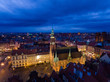 Aerial: Tower of City Hall in Wroclaw at night