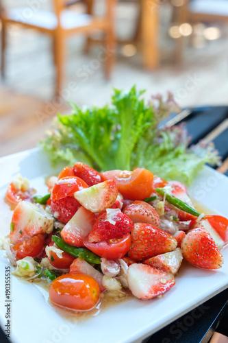 fresh strawberry spicy salad in Thai style food