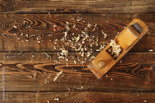 Fotografie, Obraz  old planer and shavings on dark wooden table