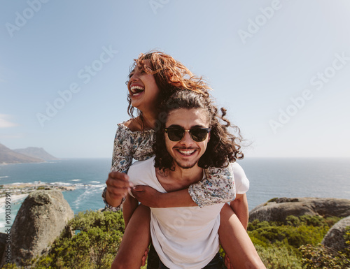 Photo  Man giving piggyback ride to his girlfriend