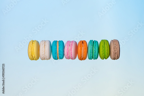 Colorful macarons cakes. Sweet french macaroons flying in motion.