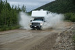 Truck Camper crossing creek on Top of the World Highway