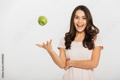 Portrait of a happy young asian woman throwing up Canvas Print