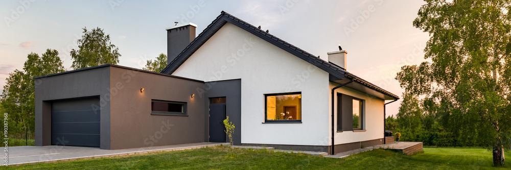Fototapeta Stylish house with large lawn
