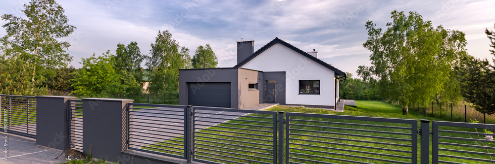 Fototapeta House with fence and garage