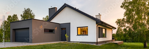 Fototapeta Stylish house with large lawn obraz