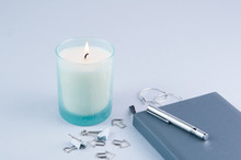 Light Blue Desktop With Journal And Candle
