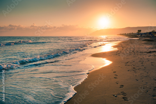 Spoed Foto op Canvas Mediterraans Europa Sunrise on the beach. Crete island, Greece