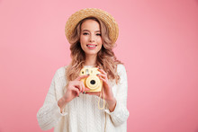Pretty Young Woman Holding Camera.