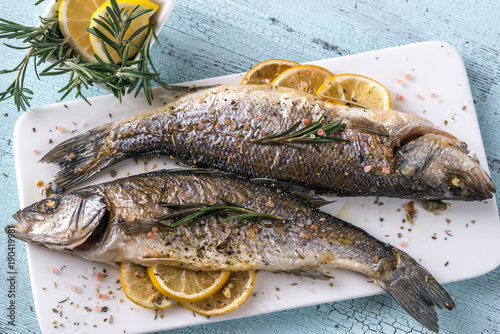 Baked sea bass with lemon and rosemary