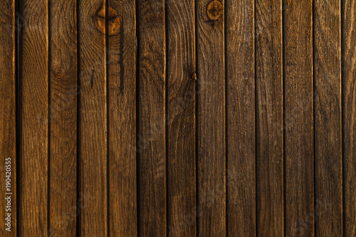 Fototapeta Texture of old wood fence alight with the rays of the setting sun.old rough not polished obraz na płótnie