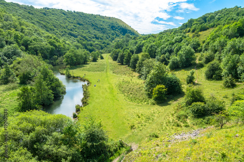 Photo A scenic view of the Monsal Dale looking north-west along the River Wye in the v