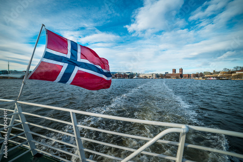 Norwegian flag on ship with Oslo in Norway in the background