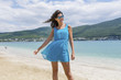 Portrait of Beautiful Happy Woman with Blue Dress on the Beach .Summer Holiday Concept