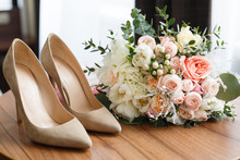 Wedding Shoes And Wedding Bouq...
