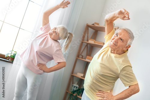 Senior couple exercise together at home health care gymnastic ...