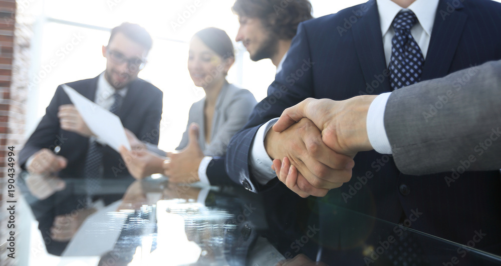 Fototapeta handshake of business partners in conference room