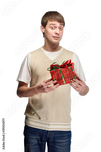 A Nice Young Man Received Birthday Present The Guy Gives Gift For Valentines Day To His Beloved Girlfriend Wife In Red Checkered