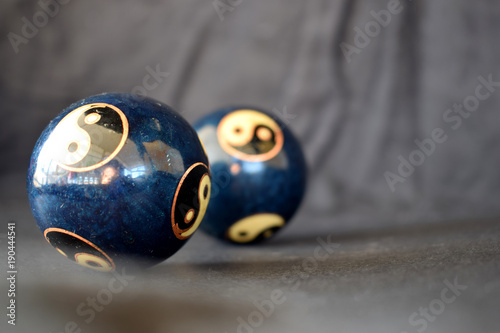 Fotografie, Obraz  Two Yin Yang balls on a black background