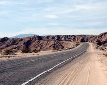 Road Through Desert Cliffs
