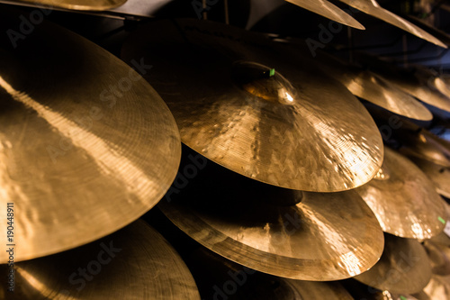 Poster Muziekwinkel cymbals at the music store