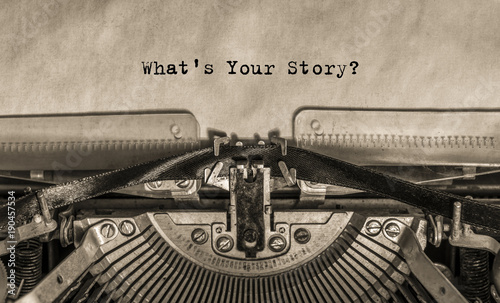 Fotobehang Retro What is your story? typed on an old vintage typewriter text.