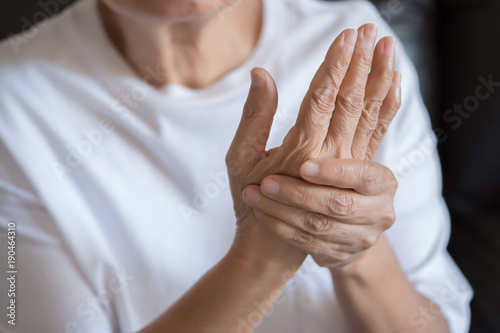 Elderly woman suffering from pain From Rheumatoid Arthritis Canvas Print