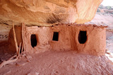 Anazazi indian ruins tucked into base of cliff southern utah desert