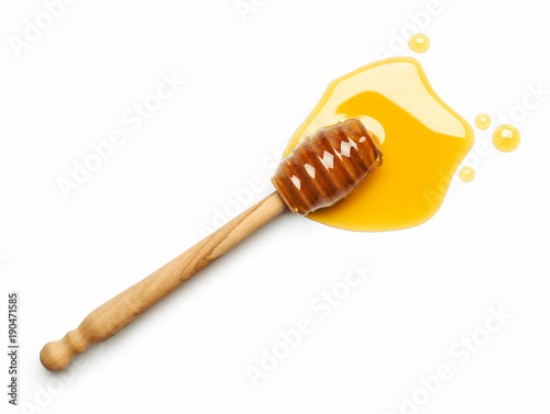 Photographie Honey dipper on white background