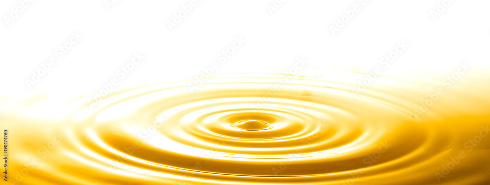 Fototapeta Liquid gold drop and ripple ,abstract background