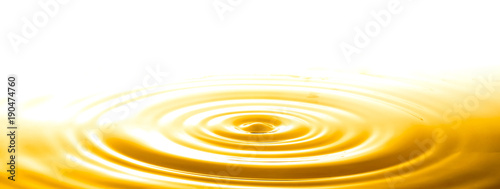 Valokuvatapetti Liquid gold drop and ripple ,abstract background