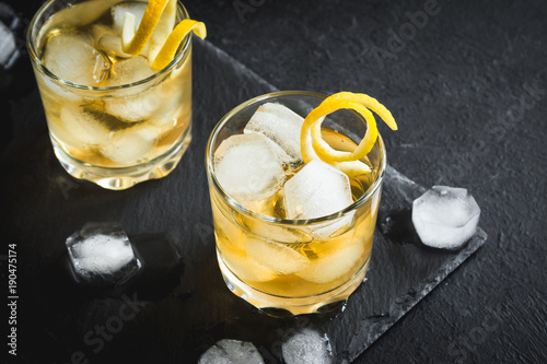 Whiskey on the rocks with lemon